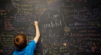 Students, parents and teachers write on our gratitude board. Photo attribution: JLewis